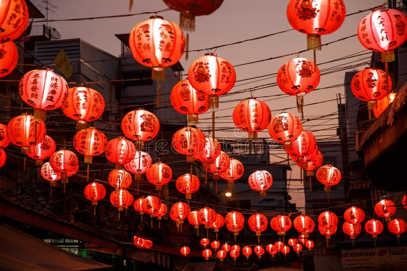 Chinese red lanterns in chinatown on chinese New Year. Bangkok,Thailand – 03.02.2019: Chinese red lanterns are hanging against the night sky over the stock photos