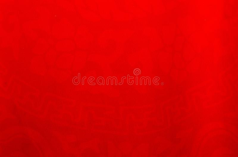 Chinese red patterned background on fabric. stock photography