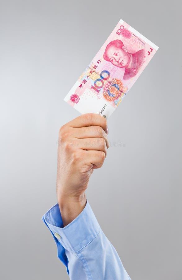Chinese Renminbi des Geschäftsmannhandgriffs hundert stockfotografie
