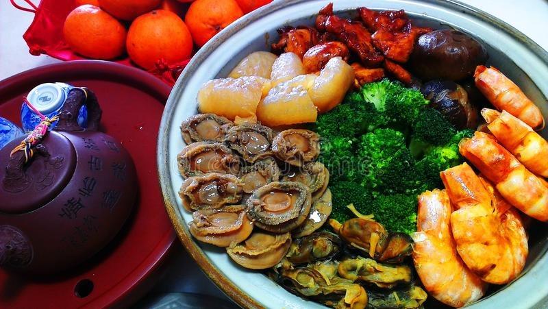 Chinese Reunion Dinner Pencai delicacies, popular auspicioius po stock photography