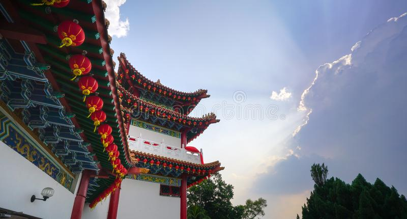 Chinese roof temple in Kuala Lumpur Malaysia. Beautiful chinese temple roof detail with colorful architectural work and lanterns hanging at Thean Hou temple royalty free stock photo