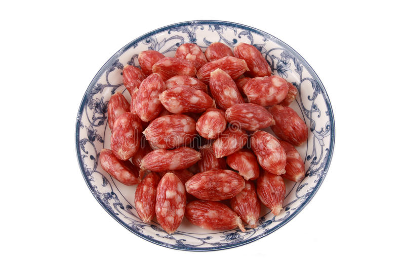 Chinese sausage. Some chinese sausage in the plate stock photos
