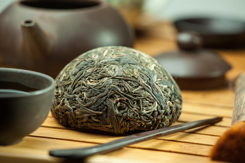Chinese shen puer tea. Shen puer chinese tea tuo cha on chaban tea table whis tea acessories in Traditional chinese tea ceremony royalty free stock photography