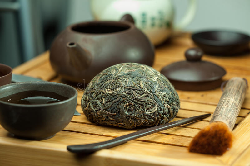 Chinese shen puer tea. Shen puer chinese tea tuo cha on chaban tea table whis tea acessories in Traditional chinese tea ceremony stock photography