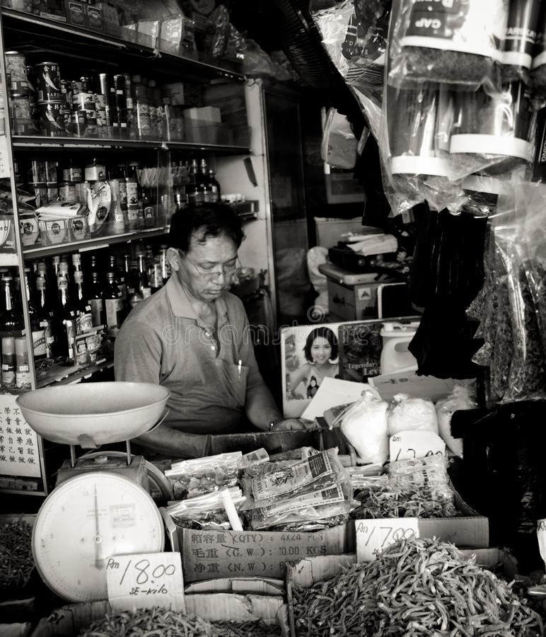 Chinese shopkeeper and his general store in the city of Kuching, Malaysia royalty free stock images