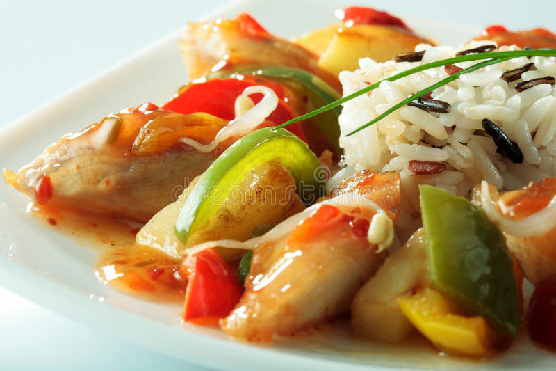 Chinese specialty with chicken, rice, vegetables and soybean sprouts close-up. On white plate royalty free stock images