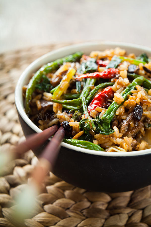 Chinese Spicy stir fry. Colorful chinese asian food - Spicy stir fry rice with chili, spnig onions, garlic, cilantro , green beans and marinated black beans stock photography