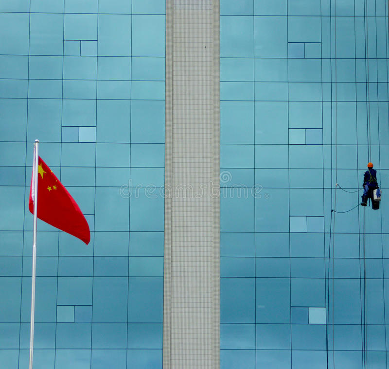 Chinese spider man. A building cleaning staff cleaning a high office building in Pudong new area of Shanghai China
