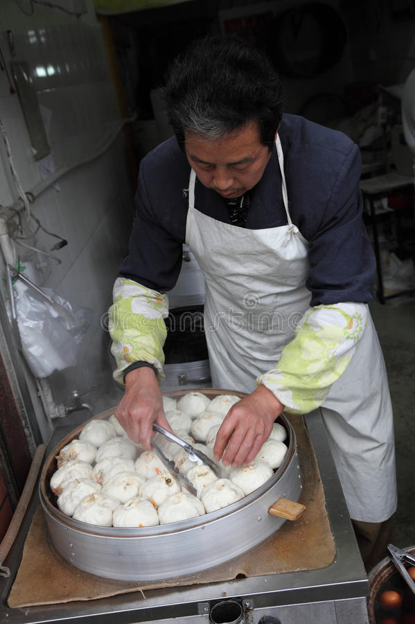Chinese steamed bun seller royalty free stock photography