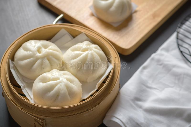 Chinese steamed buns on wood container , selective focus royalty free stock image