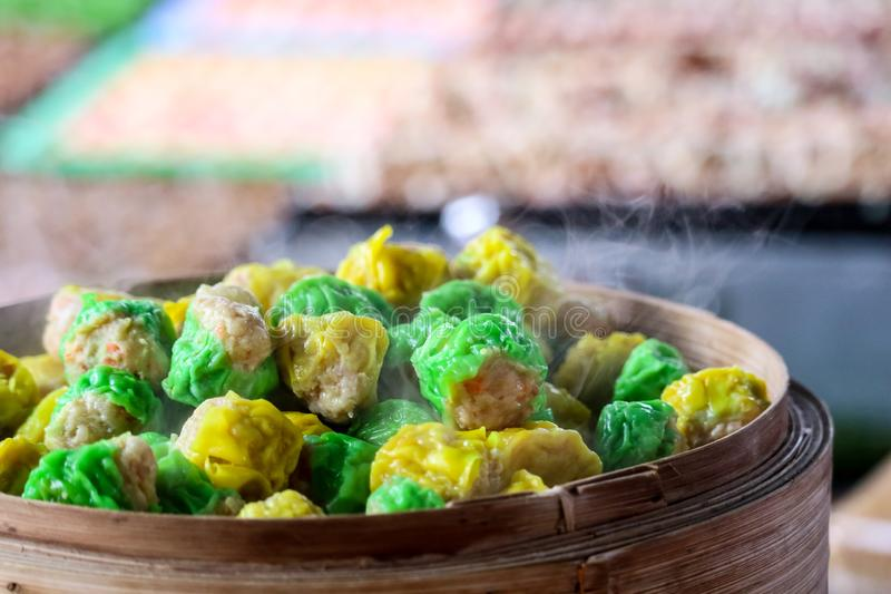 Chinese steamed dumpling on street food famous in pattaya city stock photos