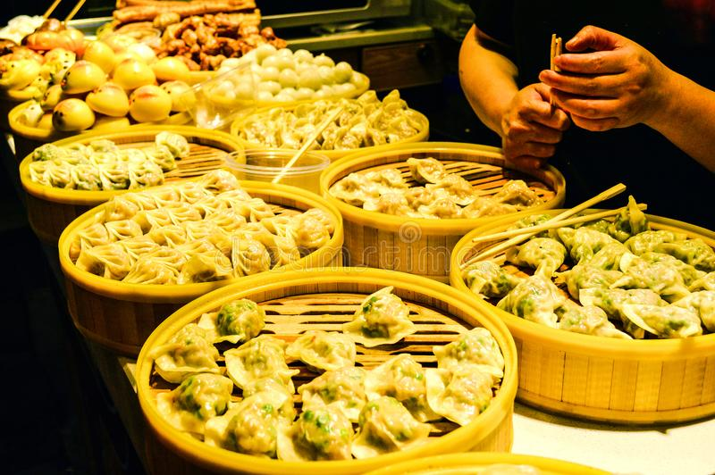 Chinese Steamed Dumplings in Bamboo Steamers royalty free stock photo