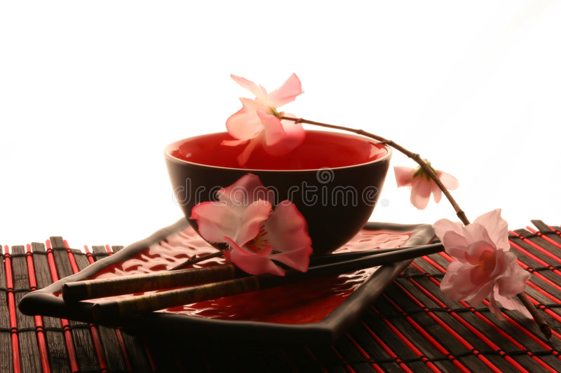 Chinese sticks, plate and cup royalty free stock images