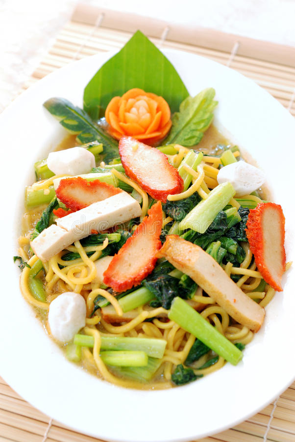 Chinese stir fried noodle. Close up Chinese stir fried noodle in white plate royalty free stock image