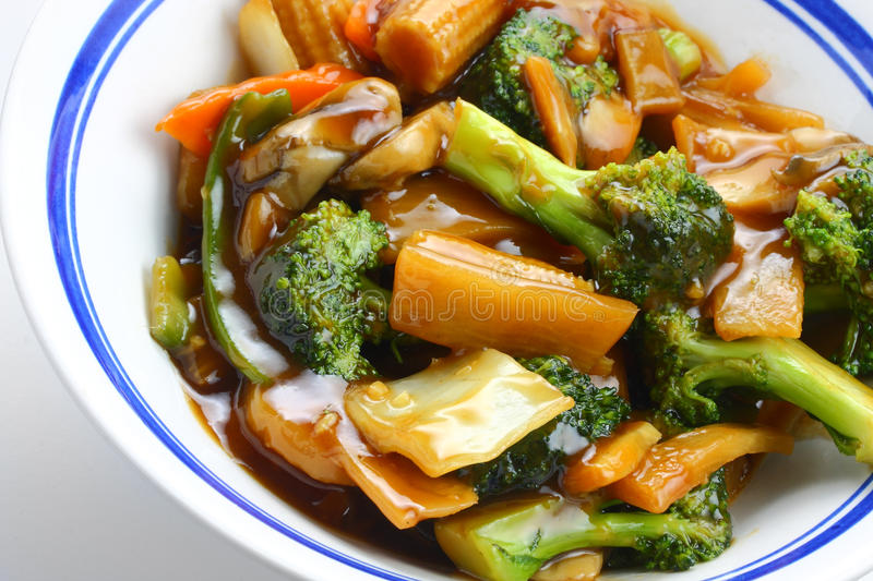 Chinese stir fry vegetables. In bowl with some background blur royalty free stock image