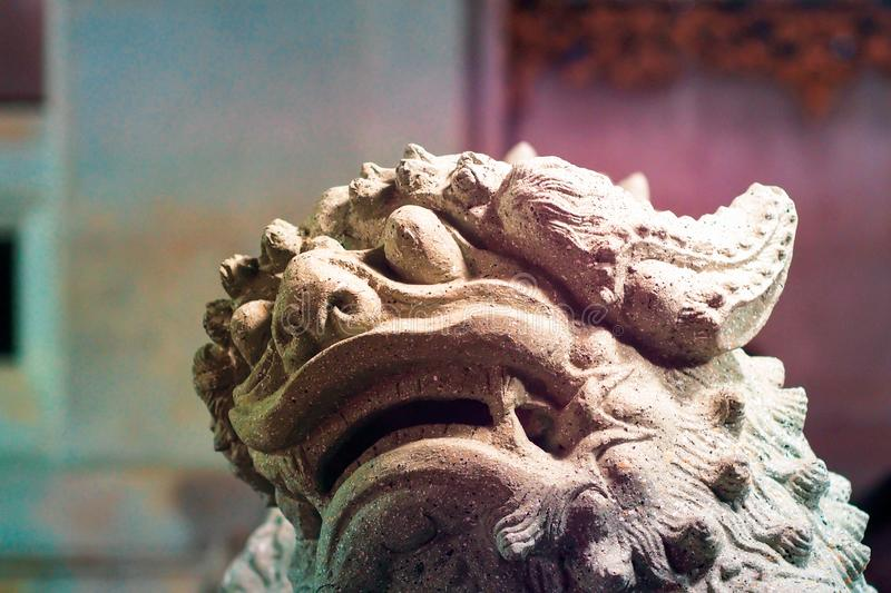 Chinese stone lion at the gate of Chinese temple in China stock photography