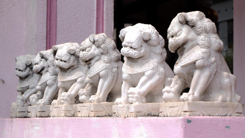 Chinese stone lion. Statue of traditional stone lion usually put in front of a door for guarding stock photography
