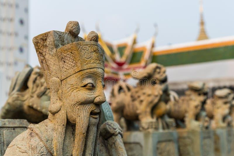 The Chinese stone sculptures decorated in Wat Arun Ratchawararam, Bangkok, Thailand stock photo