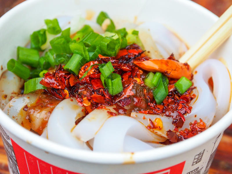 Chinese street food: Sichuan style extremely hot and spicy noodle in Chengdu, China stock photo