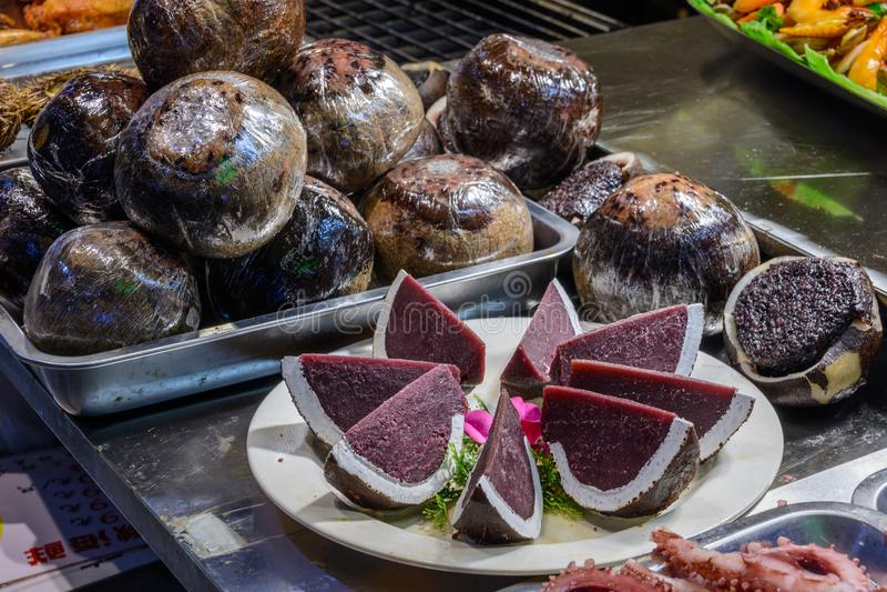 Chinese street food. Street trading. Chinese kinds of fresh seafood at an asian seafood market in Sanya, Hainan province, China. Sanya, Hainan/China - January 7 royalty free stock photo