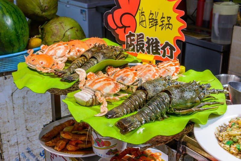Chinese street food. Street trading. Chinese kinds of fresh seafood at an asian seafood market in Sanya, Hainan province, China. Sanya, Hainan/China - January 7 stock photo