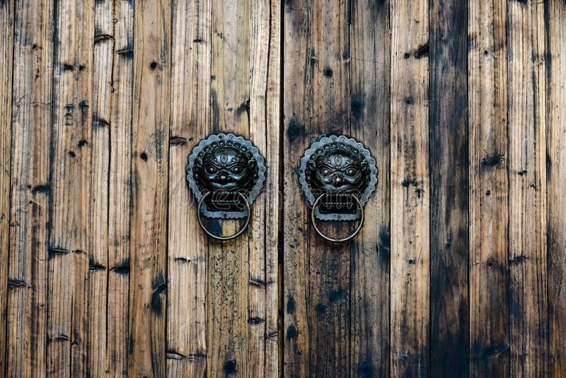 Chinese Style ancient door metal knocker lion handle , mottled and brass wooden door knocker royalty free stock image