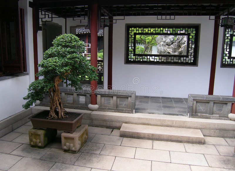 Chinese style architecture. An image of the entrance to an ancient Chinese style house or gardens. Traditional china architecture, with carved wooden window royalty free stock photography