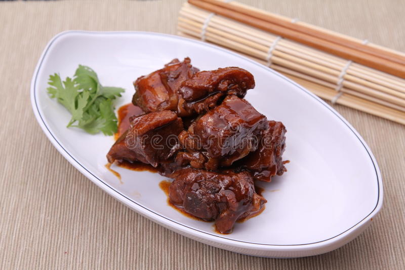 Chinese style of deep fried chicken on white plate on bamboo tray royalty free stock images