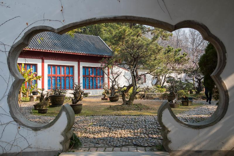 Chinese style garden gate. Traditionaly desined chiese style gate and garden stock photography
