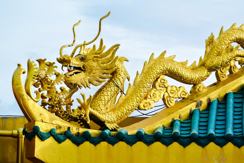 Chinese style golden dragons on the roof. stock photo