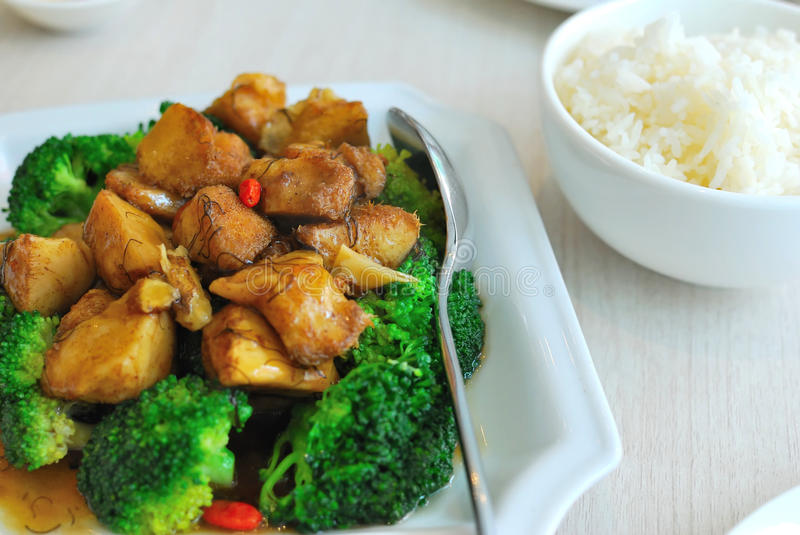 Chinese style mushrooms and cauliflower with rice. Sumptuous looking Chinese vegetarian mock meat made from monkey head mushrooms with green broccoli. Suitable royalty free stock photo