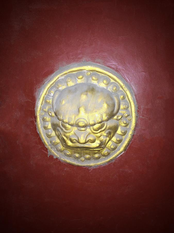 Chinese-style old gold lion head door knob royalty free stock image