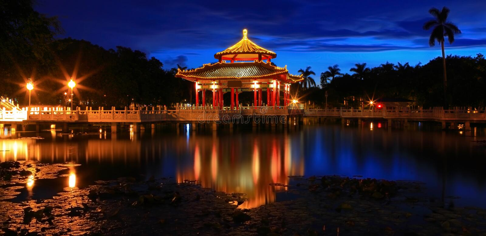 Chinese style pavilion in the night. With reflection of light royalty free stock image