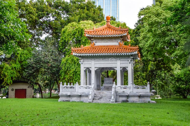 Chinese style pavilion in the park for the general public to sit and relax at Lumpini public park, Bangkok, Thailand stock photo