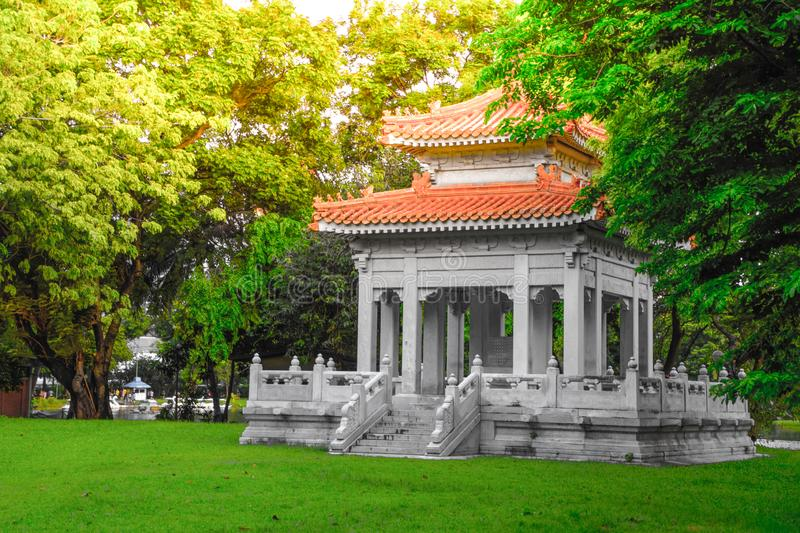 Chinese style pavilion in the park for the general public to sit and relax at Lumpini public park, Bangkok, Thailand stock image