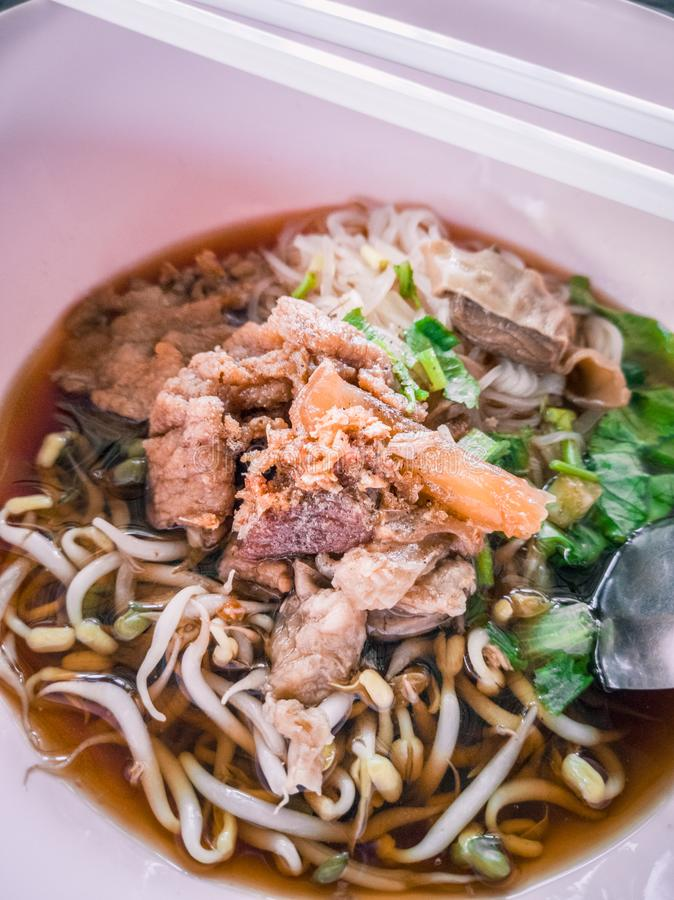Chinese style stewed meat noodle soup royalty free stock photo