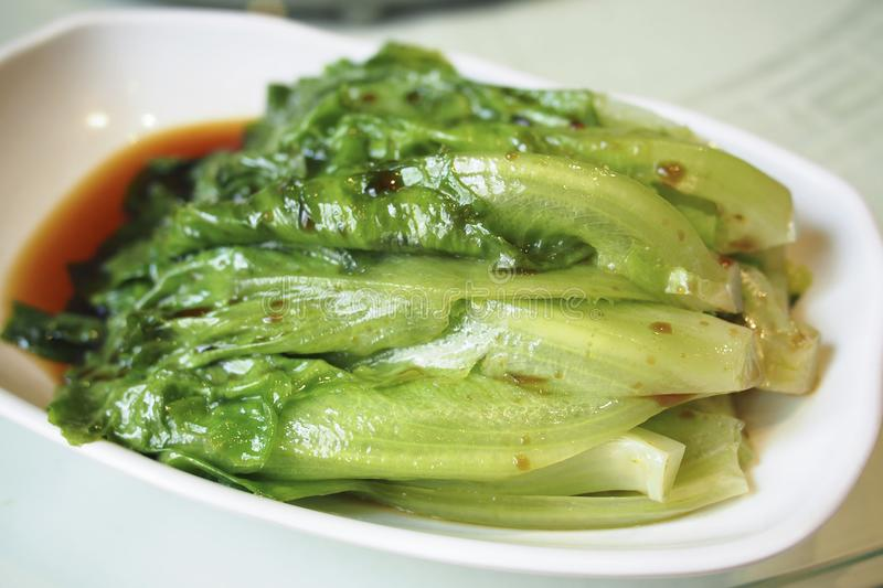 Chinese style stir fried vegetable, lettuce. Chinese style stir fried vegetable served in the restaurant stock photography