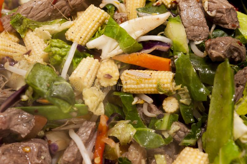 Chinese style stir fry beef and vegetables. In a sweet chilli sauce royalty free stock photography