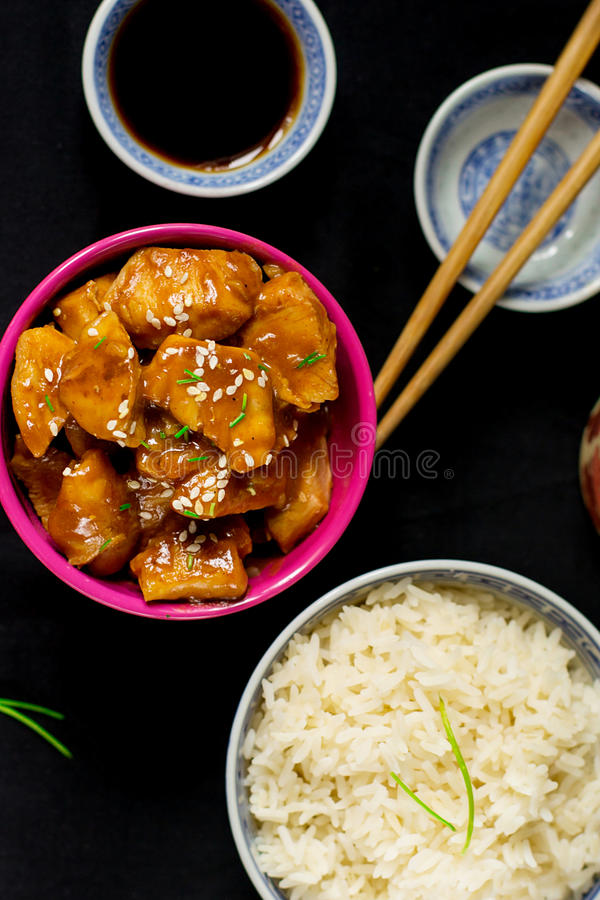 Chinese style sweet and sour chicken with sesame seeds stock photography