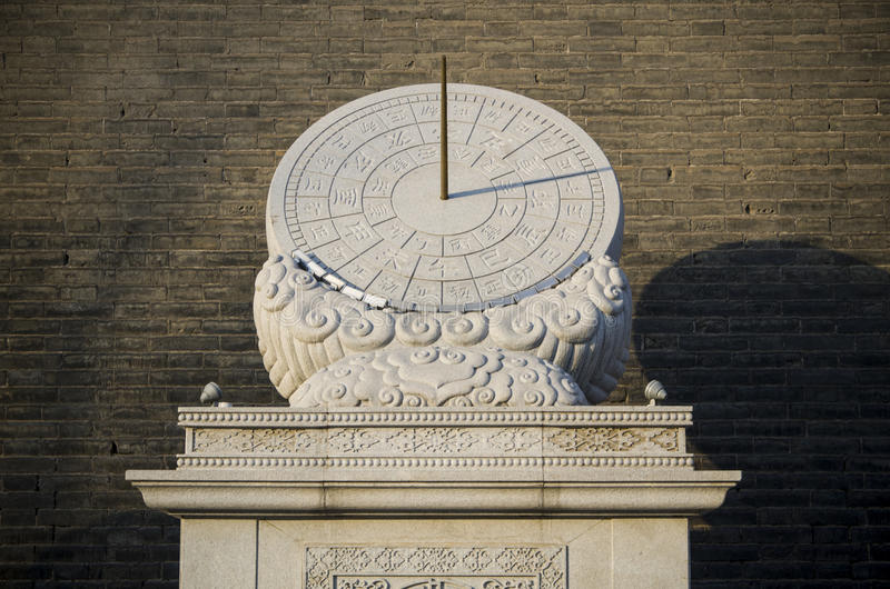 Chinese sundial. In front of the city wall stock image