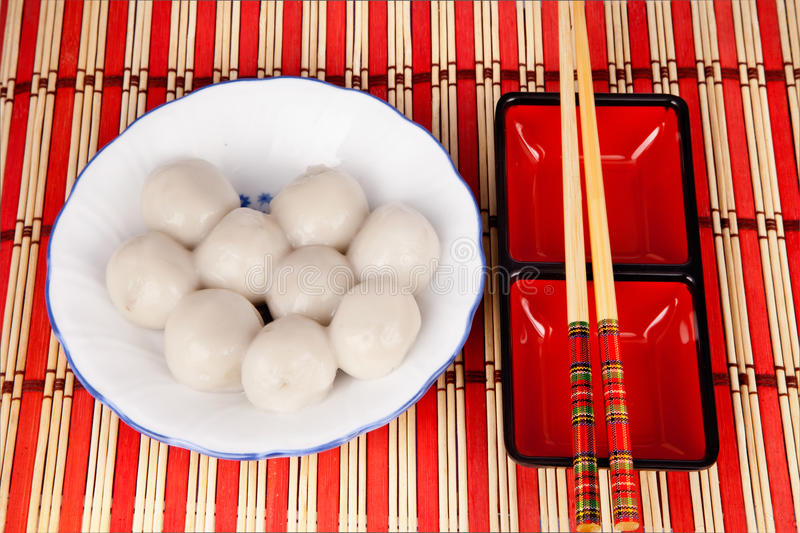 Chinese sweet dumplings. Chinese traditional sweet dumplings with chopsticks stock images