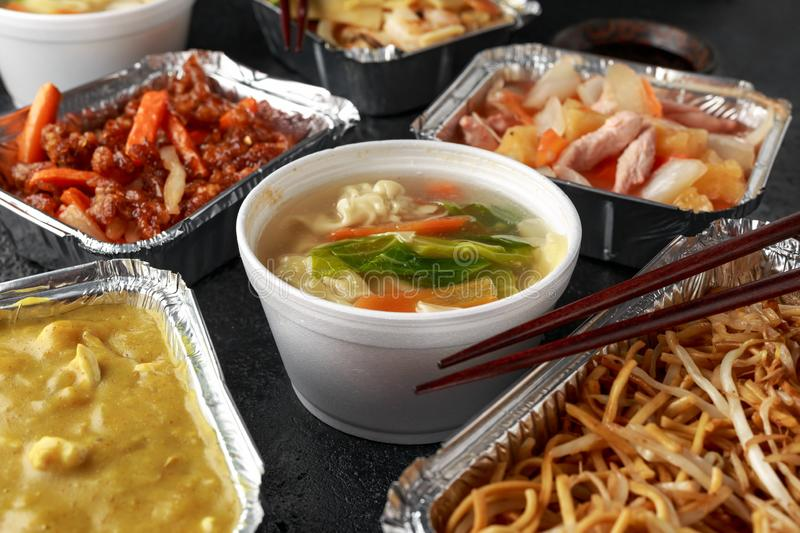 Chinese takeaway food. Pork Wonton dumpling soup, Crispy shredded beef, sweet and sour pineapple chicken, egg noodles royalty free stock photo