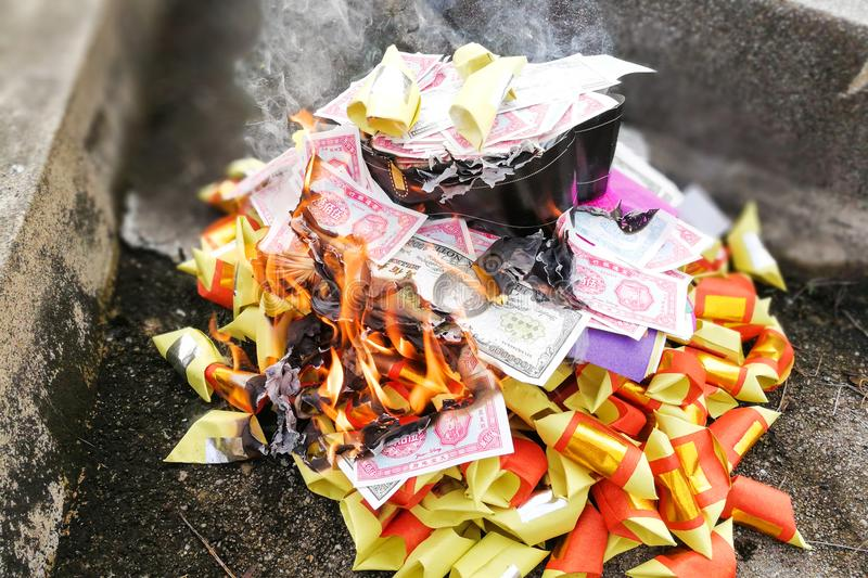 Chinese taoism tradition burn paper money and gold to ancestors stock photos