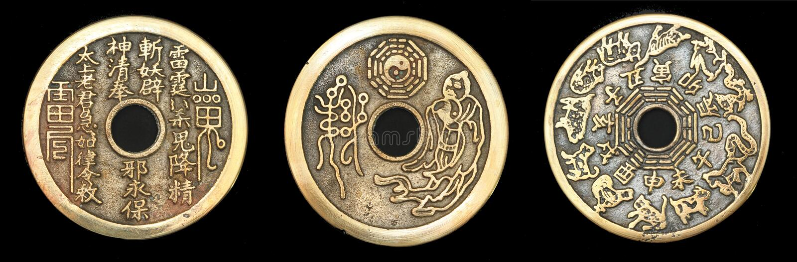 Taoist coins. Bagua and Hexagrams on Chinese Taoist Coins which gives luck and protection stock image