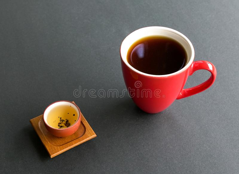 Chinese tea or Americano. Tea or coffee. Preference for either tea or coffee. Eastern or western culture contrast concept stock photography
