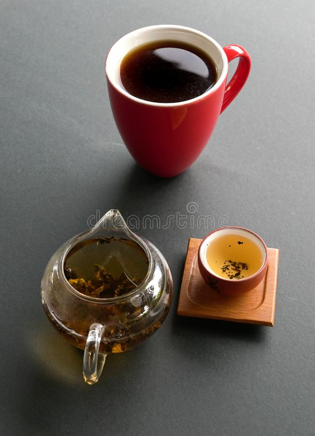 Chinese tea or Americano. Tea or coffee. Preference for either tea or coffee. Eastern or western culture contrast concept royalty free stock photography