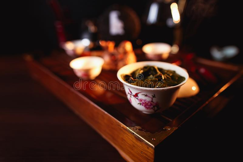 Chinese tea ceremony. Cup of tea on tea desk chaban. Soft selective focus stock photos