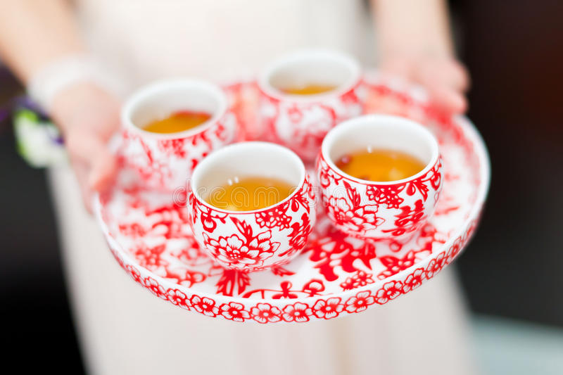 Chinese tea ceremony cups in wedding day royalty free stock images