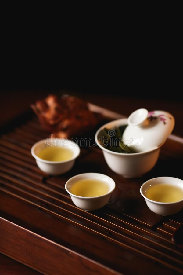 Chinese tea ceremony. Tea set on tea desk chaban with golden frog. Soft selective focus royalty free stock images