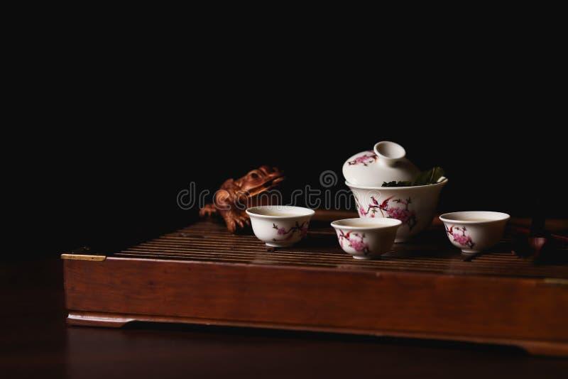 Ea set on tea desk chaban with golden frog. Chinese tea ceremony. Tea set on tea desk chaban with golden frog.  Soft selective focus royalty free stock image